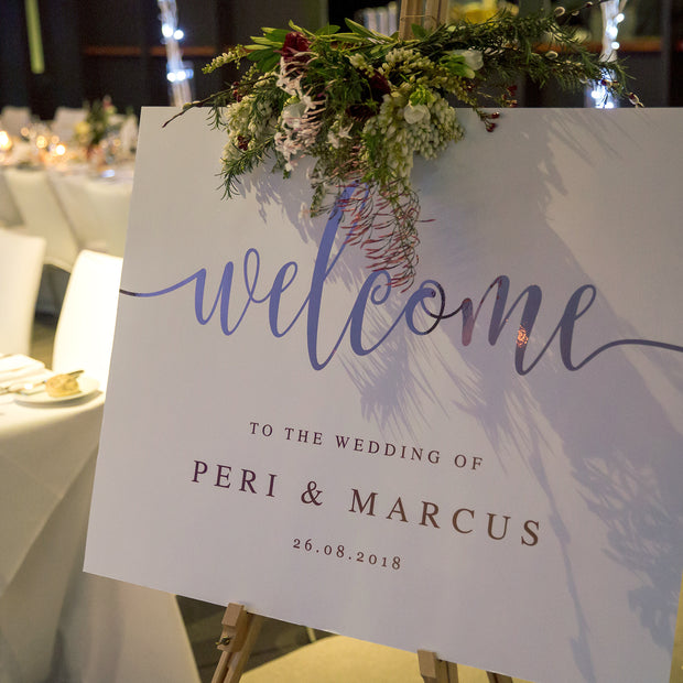 Beautiful wedding welcome sign with rose gold foil