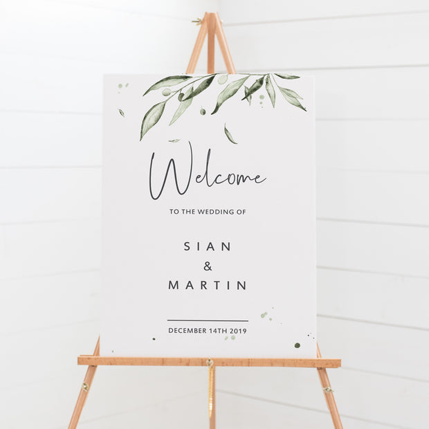 Wedding welcome sign with modern script font in charcoal grey and watercolour olive leaves