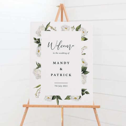 Wedding welcome sign board with white floral and greenery border
