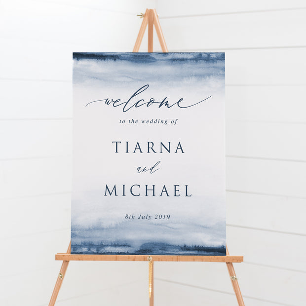 Wedding welcome sign with navy watercolour background and calligraphy font