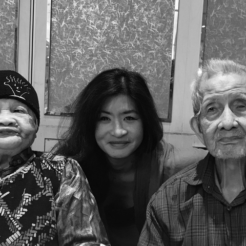 Lily, founder of EK with her grandparents in Hong Kong