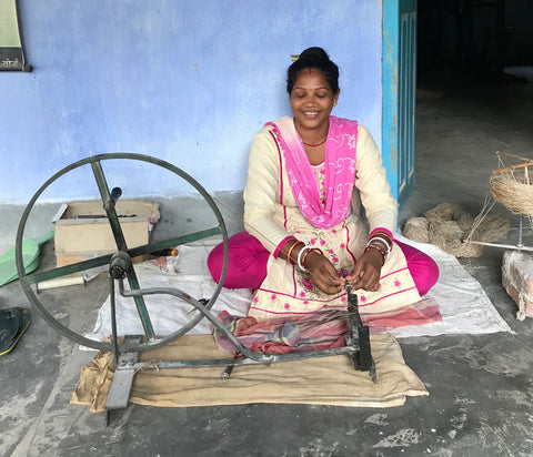Woman spinning peace silk yarn in India