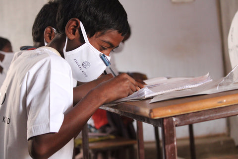 Young boy studying in class at Marghantu middle school, India JPG