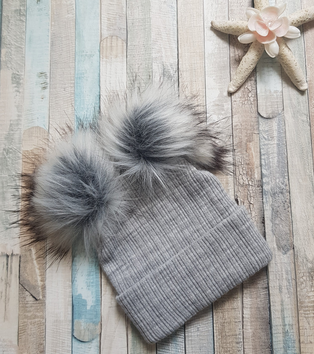 knitted grey faux fur double pom pom hat