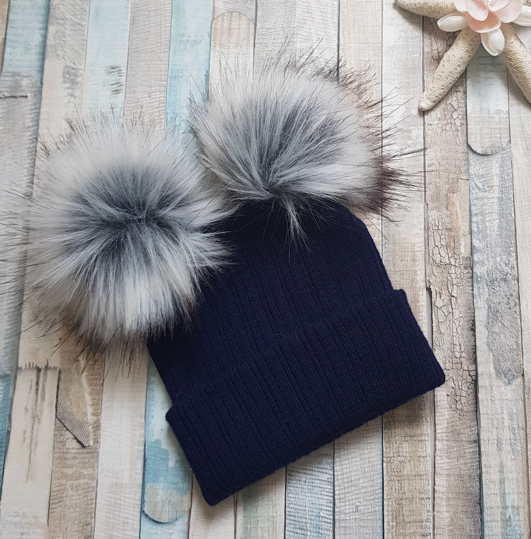 Knitted navy faux fur double pom pom hat