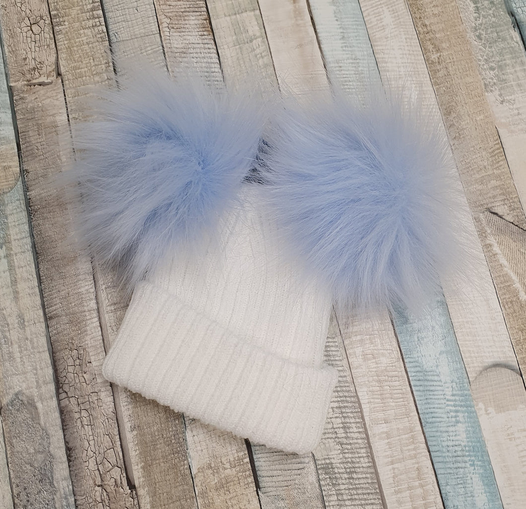 white knitted hat blue double pom pom