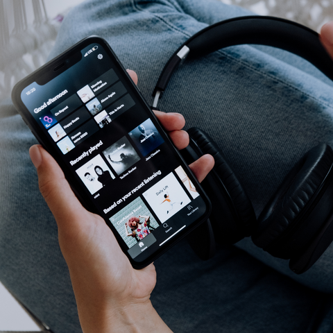spotify on iphone in hand