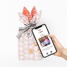 Load image into Gallery viewer, Phone tapping Tokki Gift Tag to view Digital Gift Card