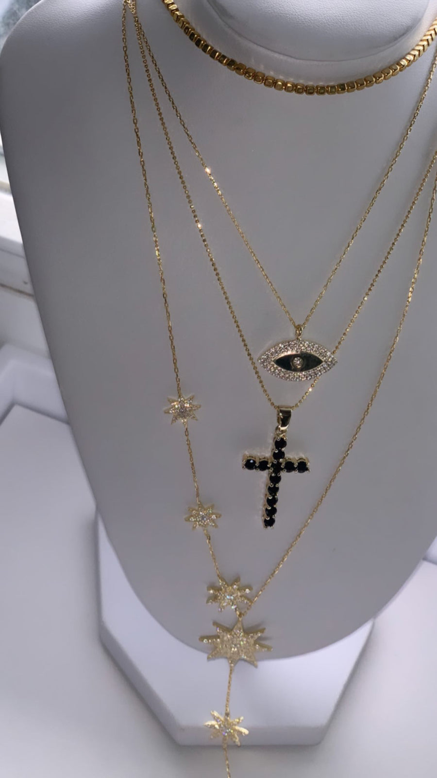 Gold plated black stone cross