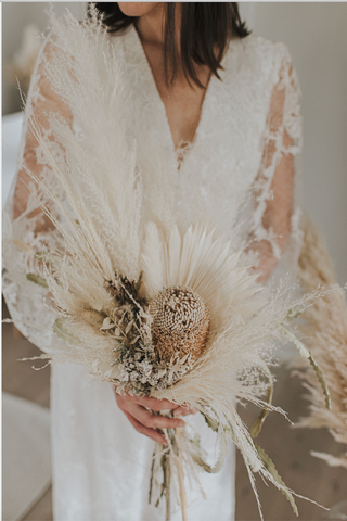 Bridal bouquet using dried florals and pampas grass. Boho inspired wedding trends