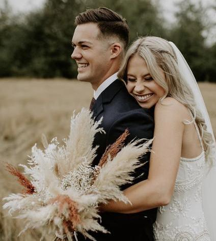 Bridal bouquet using pampas grass and other dried florals, boho and minimalist wedding trends; Golden August