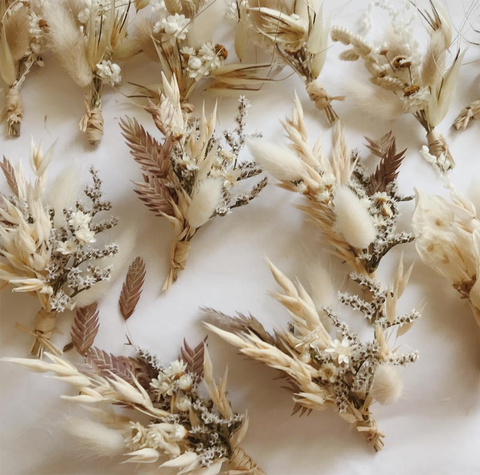 Simple, white dried wedding boutonnieres for groomsmen and groom