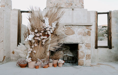 Dried floral wedding installation (install) with dried palm spears, dried pampas grass, dried roses, and baby's breath