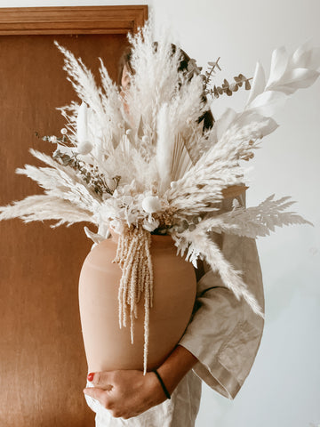 Dried floral vase arrangements and bouquets using pampas grass, dried palm spears, and other dried florals for boho, minimalist home decor inspiration