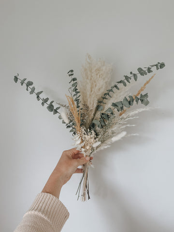 Dried floral wedding bouquet for bridesmaids using pampas grass, eucalyptus, bunny tails, and baby's breath