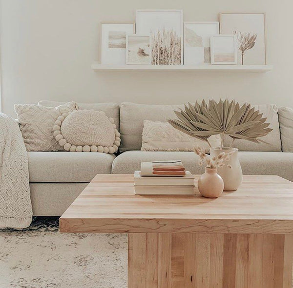 Palm suns on a coffee table in a living room. Minimalist, boho home decor inspiration. Dried florals, dried pampas grass, dried palms