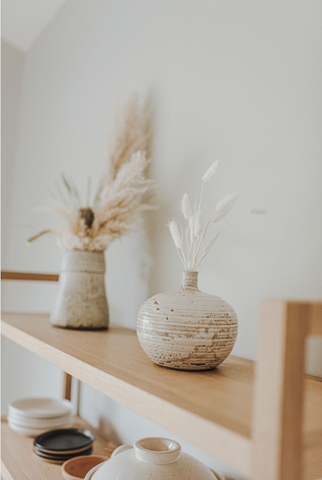 Dried bunny tails on a shelf. Minimalist, boho, home decor inspiration