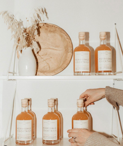 Refreshing gin cocktails for summer on a shelf with dried florals