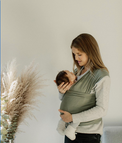 All-natural baby wraps made out of organic material; pampas grass in the background