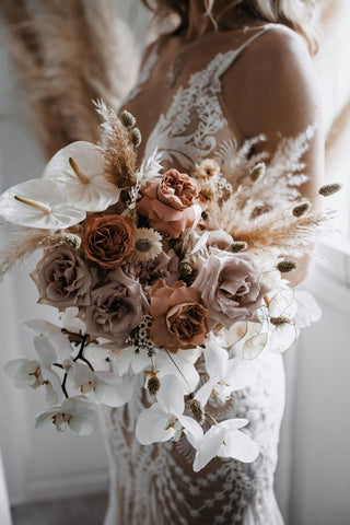 Toffee coloured roses and white flower bridal bouquet with a mix of fresh and dried florals
