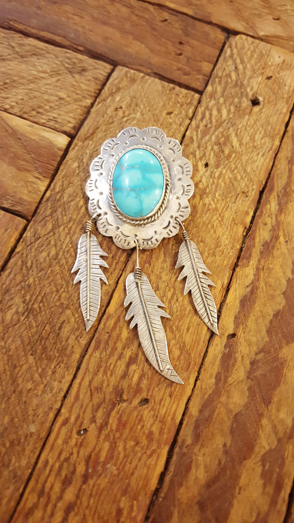 Feather shield pin