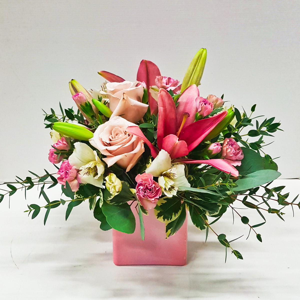 Lilies, roses, carnations, alstroemeria, cube vase - all pink flowers in this cube arrangement.  Edmonton flowers, order flowers, flower delivery, valentine's day