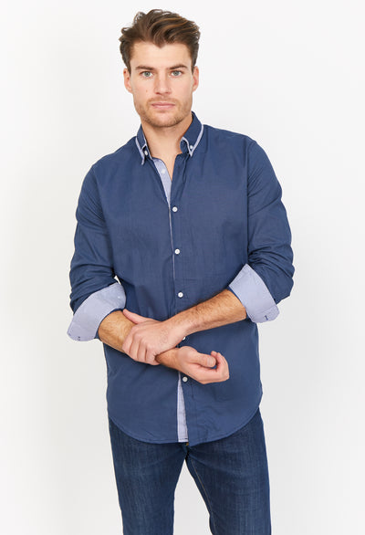 Man Wearing Blue Button Up Dress Shirt