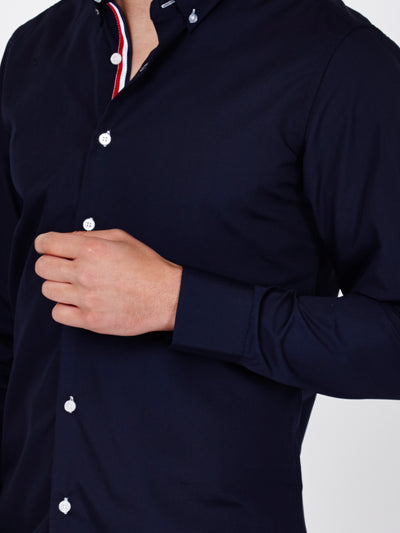 Man Wearing Dark Blue Button Up Dress Shirt