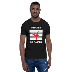 Young black guy wearing praise breakn tshirt.   This t-shirt feels soft and lightweight, with the right amount of stretch. It's comfortable and flattering for both men and women.