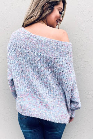Loose blue knit sweater