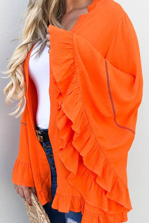 Ruffled orange cardigan
