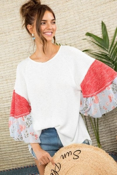 White knit raglan top with contrasting sleeves