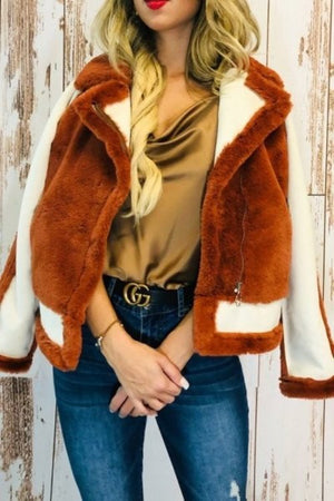 Red and cream colored fur coat