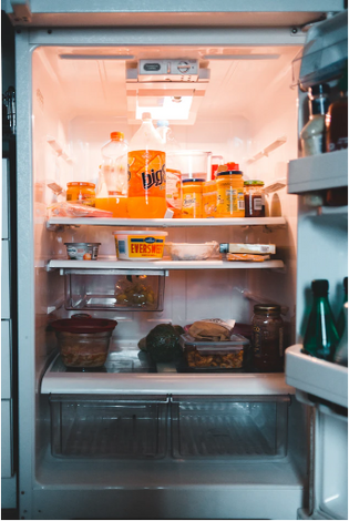 Refrigerator stocked with snacks