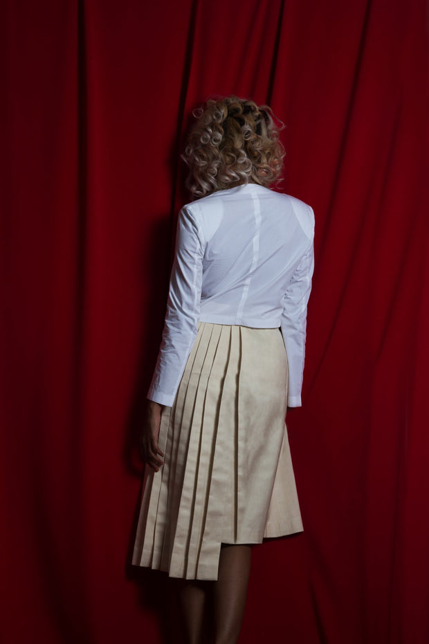 Back view of unfinished letter pleated silk skirt