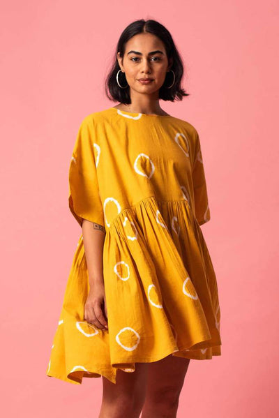 Close up of Norblack Norwhite handloom 100% cotton mustard mini dover ring dress at Omi Na-Na