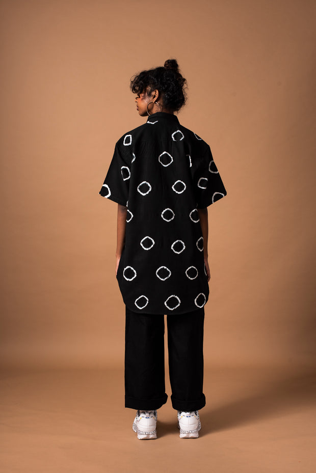 Back of black unisex ring shirt with short sleeves in 100% cotton