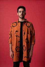 Front of unisex terracotta oversized boyfriend ring shirt in 100% cotton (male model)