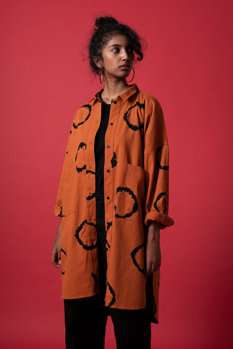 Front-side of unisex terracotta oversized boyfriend ring shirt in 100% cotton
