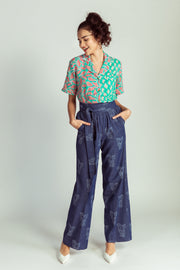 Front of denim flared trousers with elephant print
