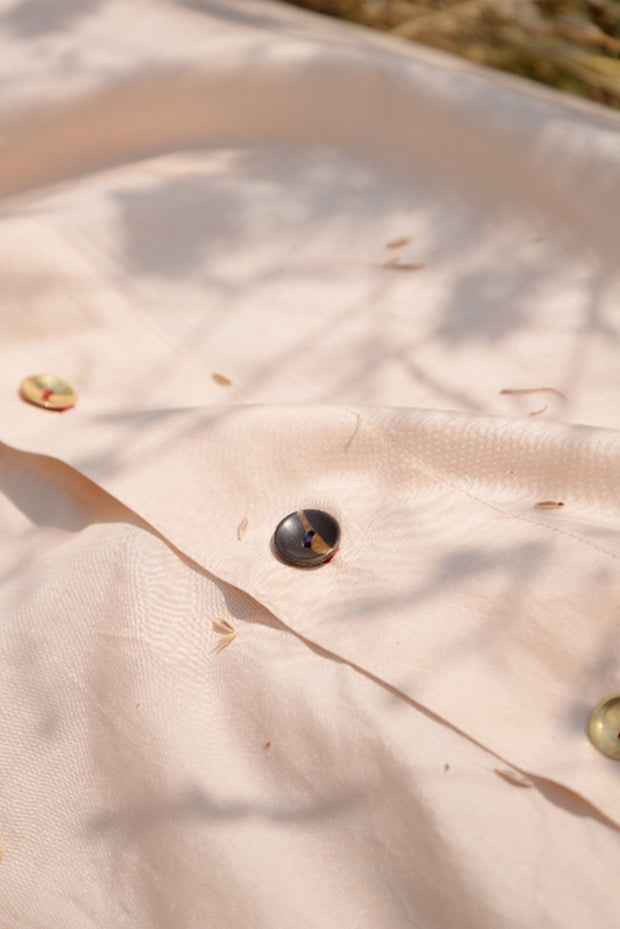 Close up of hand made buttons on the feminist shirt dress in cotton silk
