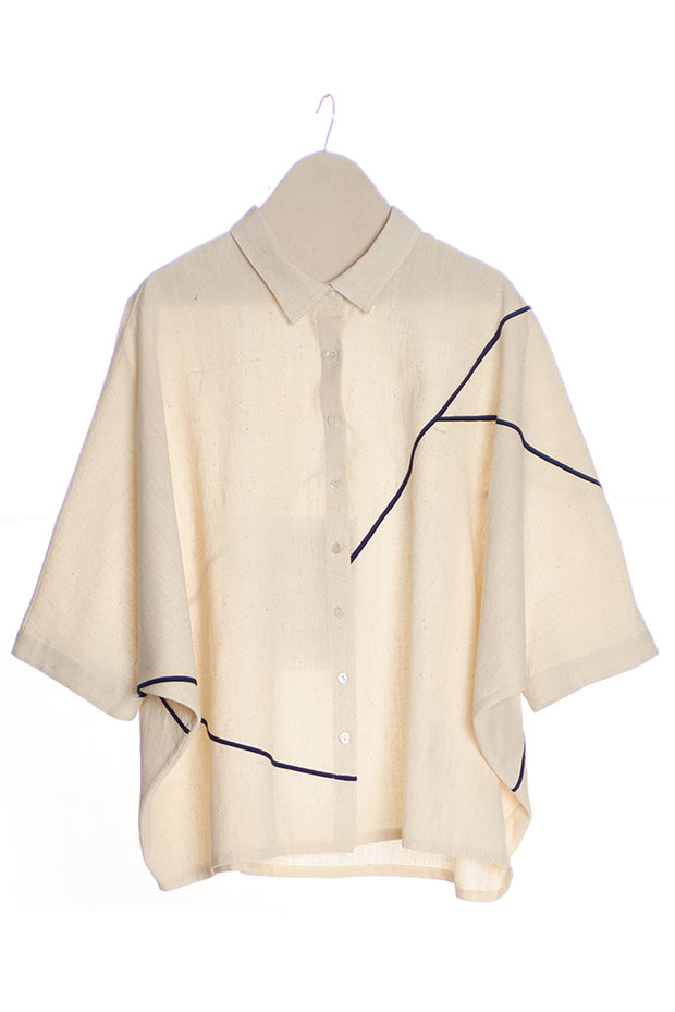 Front of women's khadi shirt in ecru with blue piping