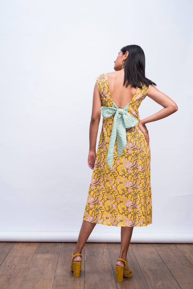Full back view of yellow swan day dress in handwoven 100% cotton