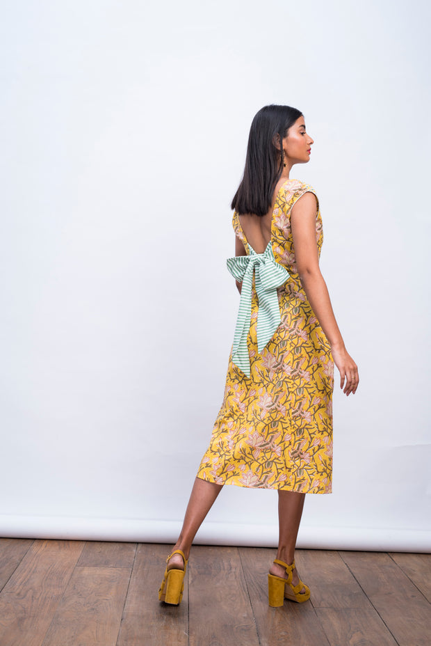 Back view of yellow swan day dress in handwoven 100% cotton