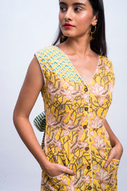 Close up of yellow swan day dress in handwoven 100% cotton