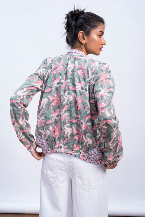 Back of womens muted octopus bomber jacket in 100% cotton