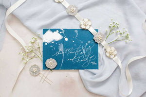 Cosmos Bridal Sash on wedding stationery