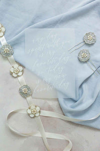 Cosmos Bridal Sash with wedding stationery