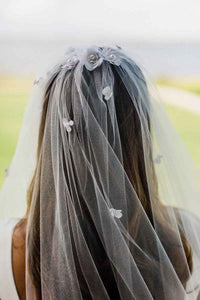Detail shot of bride wearing Camellia bridal veil with floral applique by Mauve et Blush