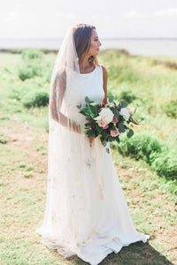 Full length portrait of bride wearing Dahlia embroidered wedding veil holding pink and white floral bouquet
